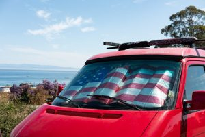 red van with American flag sun protector