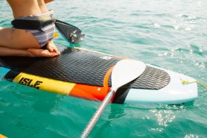 close up of a stand up paddle board deck pad and girls back